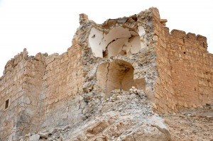 This photo released by the Syrian official news agency SANA, shows damage to the Palmyra citadel following fighting between Government forces and Islamic State group militants in Palmyra, Syria, Sunday, March 27, 2016. Syrian state media and an opposition monitoring group say government forces backed by Russian airstrikes have driven Islamic State fighters from the historic central town of Palmyra, held by the extremists since May. (SANA via AP)